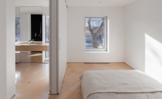 The eight-metre-square master bedroom is separated from the bathroom by space-saving pocket doors.